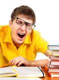 Estudiante cansado que bosteza Fotografía de archivo