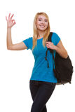Estudiante casual de la muchacha con la mochila del bolso que muestra MUY BIEN aislado Imagen de archivo