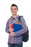 Estudiante caucásico sonriente con la mochila y el libro aislados en whi Fotos de archivo