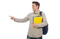 Estudiante caucásico sonriente con la mochila y el libro aislados en whi Fotos de archivo libres de regalías