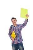 Estudiante caucásico sonriente con la mochila y los libros aislados en wh Fotos de archivo