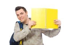 Estudiante caucásico sonriente con la mochila y los libros aislados en wh Imágenes de archivo libres de regalías