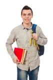 Estudiante caucásico sonriente con la mochila y los libros aislados en wh Foto de archivo libre de regalías