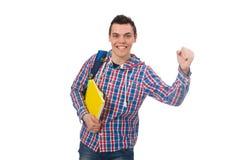 Estudiante caucásico sonriente con la mochila y los libros aislados en wh Imagen de archivo