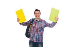 Estudiante caucásico sonriente con la mochila y los libros aislados en wh Imagenes de archivo
