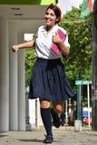 Estudiante colombiana linda Running With Notebook fotografía de archivo libre de regalías