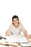 Estudiante con dos teléfonos Foto de archivo libre de regalías