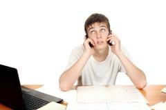 Estudiante con dos teléfonos Imagen de archivo