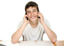 Estudiante con dos teléfonos Fotografía de archivo
