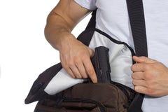 Estudiante con el arma Imagen de archivo libre de regalías