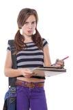 Estudiante con el cuaderno de notas Foto de archivo libre de regalías