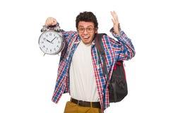 Estudiante con el despertador Foto de archivo libre de regalías