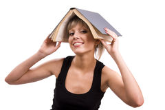 Estudiante con el libro en su cabeza Imagenes de archivo