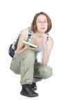 Estudiante con el morral y el cuaderno. Foto de archivo libre de regalías