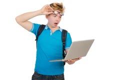 Estudiante con el ordenador portátil aislado en blanco Fotografía de archivo