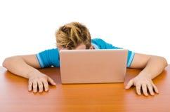 Estudiante con el ordenador portátil en blanco Fotografía de archivo libre de regalías