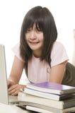 Estudiante con el ordenador y los libros Imagen de archivo libre de regalías
