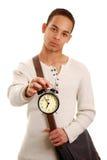 Estudiante con el reloj de alarma Fotos de archivo libres de regalías