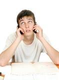 Estudiante con el teléfono Fotografía de archivo libre de regalías
