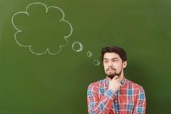 Estudiante con la burbuja del pensamiento Foto de archivo libre de regalías