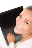 Estudiante con la computadora portátil Fotos de archivo