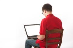 Estudiante con la computadora portátil Imágenes de archivo libres de regalías