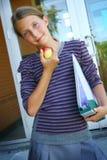 Estudiante con la manzana Foto de archivo libre de regalías