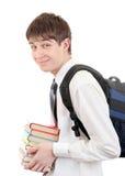 Estudiante con la mochila que sostiene los libros Fotografía de archivo libre de regalías