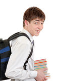 Estudiante con la mochila que sostiene los libros Foto de archivo