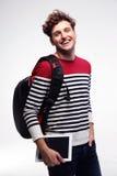 Estudiante con la mochila y la tableta Fotografía de archivo