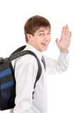 Estudiante con la onda de la mochila adiós Foto de archivo