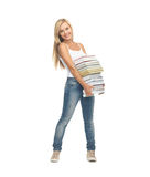 Estudiante con la pila de libros Foto de archivo libre de regalías