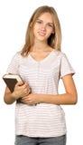 Estudiante con la pila de libros Imágenes de archivo libres de regalías