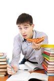 Estudiante con la pizza Foto de archivo libre de regalías
