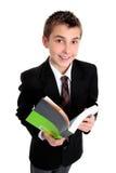 Estudiante con la sonrisa del libro de texto Fotografía de archivo