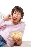 Estudiante con las patatas a la inglesa Foto de archivo libre de regalías