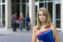 Estudiante con los cuadernos Fotografía de archivo libre de regalías