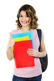 Estudiante con los cuadernos aislados en blanco Fotografía de archivo libre de regalías