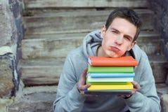 Estudiante con los libros Imagen de archivo libre de regalías
