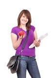 Estudiante con los libros, el bolso y la manzana Imágenes de archivo libres de regalías