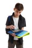 Estudiante con los libros y el equipo Fotos de archivo