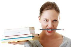 Estudiante con los libros y el lápiz Imagenes de archivo