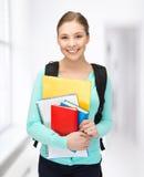 Estudiante con los libros y la cartera Fotos de archivo