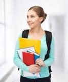 Estudiante con los libros y la cartera Imagenes de archivo