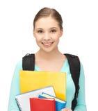 Estudiante con los libros y la cartera Foto de archivo