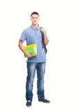 Estudiante con los libros y la mochila aislados en blanco Imágenes de archivo libres de regalías
