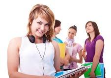 Estudiante con los libros y los auriculares Fotografía de archivo