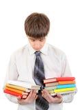 Estudiante con muchos libros Imagen de archivo libre de regalías