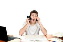 Estudiante con muchos teléfonos Imágenes de archivo libres de regalías