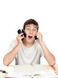 Estudiante con muchos teléfonos Imagen de archivo libre de regalías